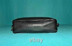 DELVAUX sac vintage en cuir noir porté épaule ou travers