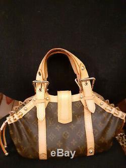 LOUIS VUITTON sac à main en cuir et toile monogrammée L V. Modèle vintage
