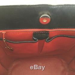 Sac CÉLINE vintage en box noir doublé de cuir rouge