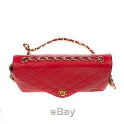 Sac Chanel Mademoiselle vintage en cuir matelassé rouge, bijouterie dorée