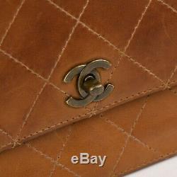 Sac Chanel vintage en cuir matelassé beige en très bon état