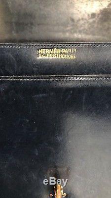 Très beau sac vintage Hermès modèle Palonnier en cuir box bleu marine